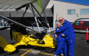 Happy couple celebrate Wedding Anniversary with powered hang glider flight - Hang Gliding Tahoe