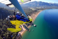 Student flying powered hang glider above Nevada Beach, SLT - Hang Gliding Tahoe