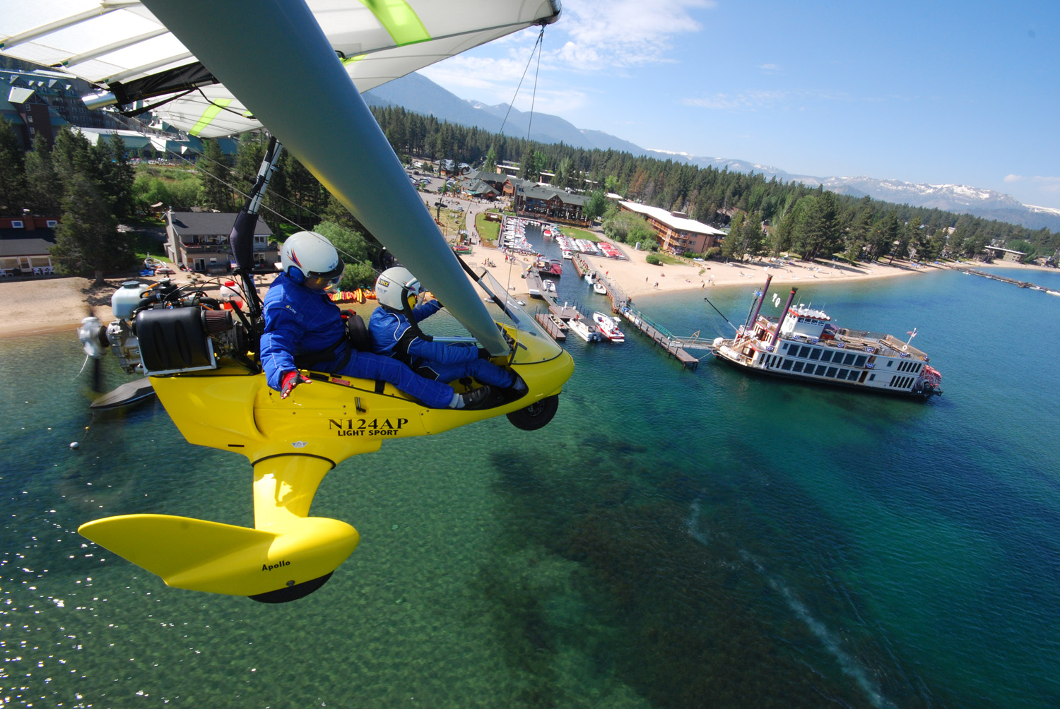Flying powered hang glider above Lake Tahoe Paddlewheeler - Hang-Gliding-Tahoe