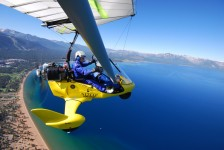 Student flying above Nevada Beach South Lake Tahoe - Hang Gliding Tahoe