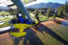 Flying powered hang glider by Edgewood Club House - Hang Gliding Tahoe