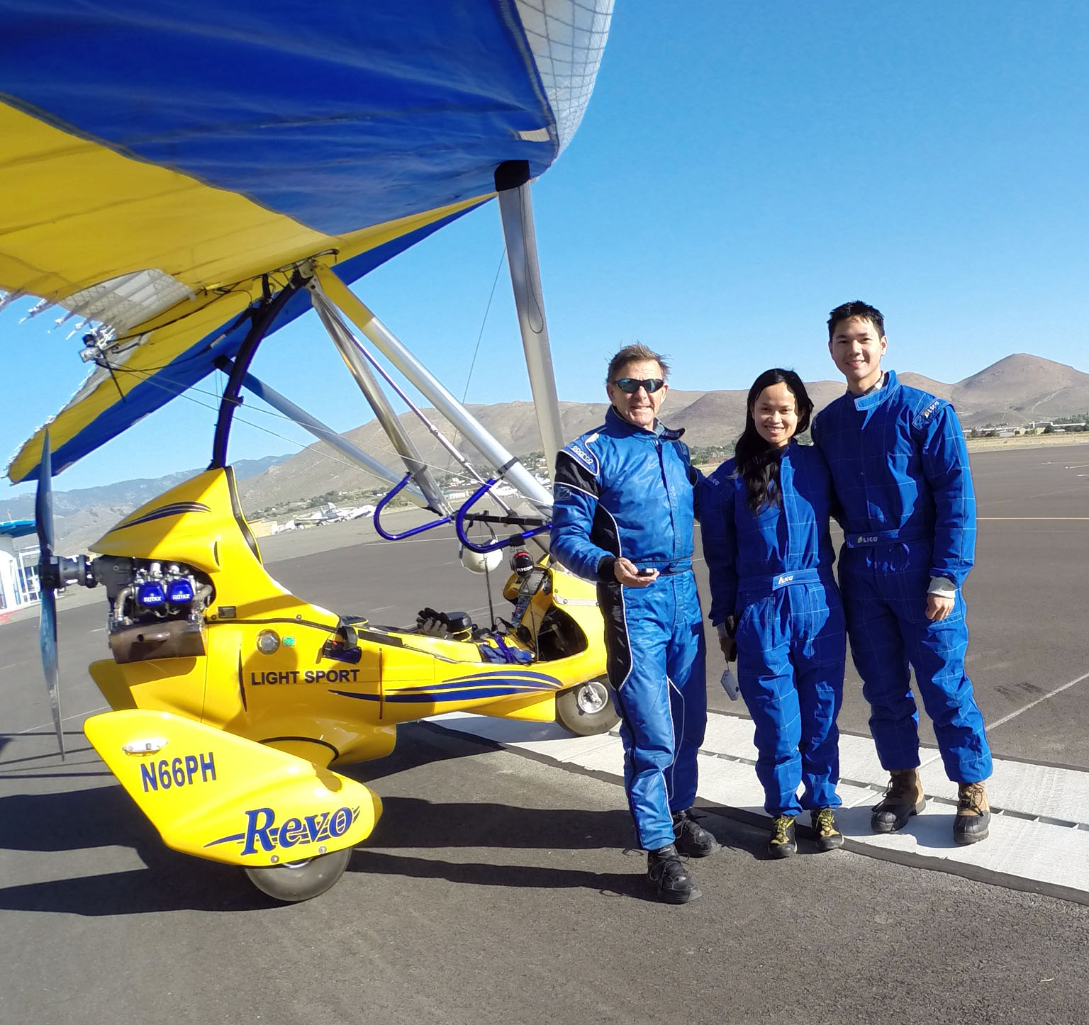 Hang Gliding Tahoe's Paul Hamilton and happy students after successful flight.