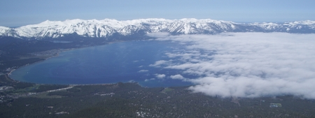 Aerial view of South Lake Tahoe with Snow covered mountains