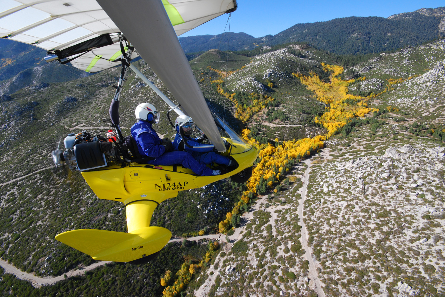 Flying a powered hang glider above fall colors on hillside - Hang Gliding Tahoe