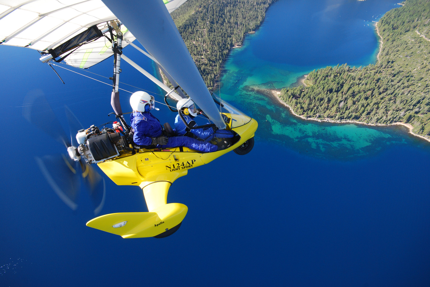 Flying powered hang glider above mouth of Emerald Bay - Hang Gliding Tahoe