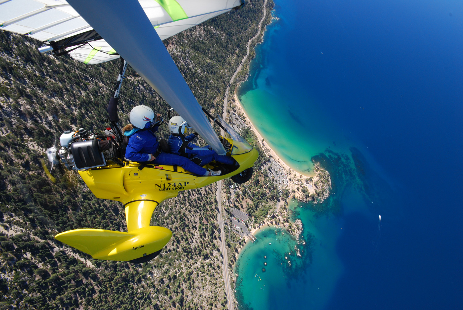 Student and Instructor in powered hang glider above Sand Harbor, Hang Gliding Tahoe